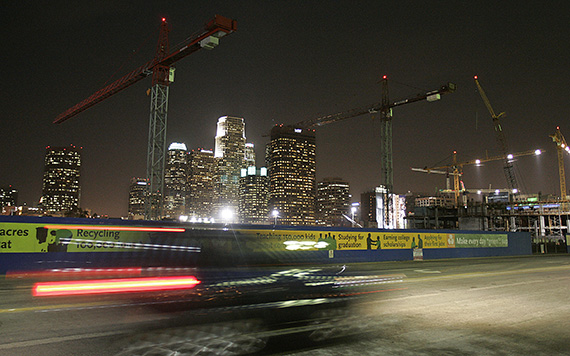 The downtown skyline is framed by cranes at a construction site near Staples Center in 2006.