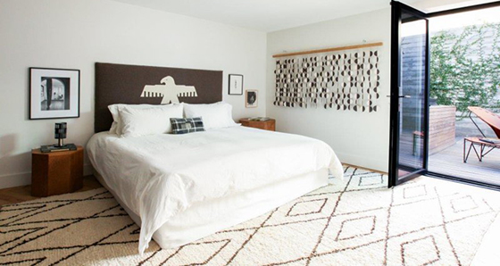 The bedroom at the penthouse designed by Heather Heron