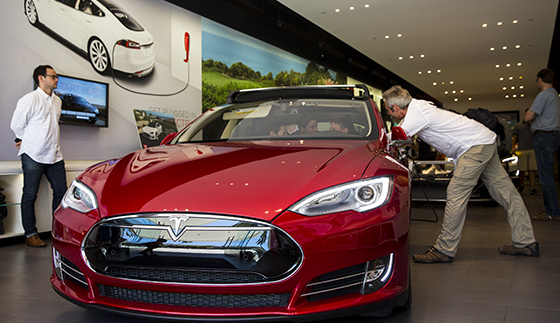 A customer looking at a Tesla Model S at the Third Street Promenade showroom in Santa Monica (Photo by Jay L. Clendenin via Getty Images)