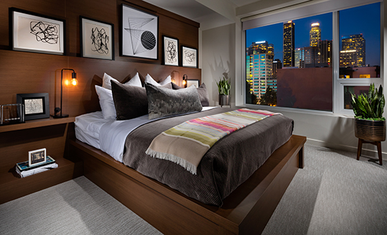 The master bedroom in a model residence at Ten50