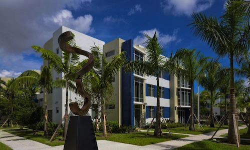 Pinnacle housing group completes first phase at kings for Achat maison miami