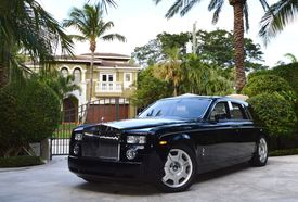 The mansion at 750 Lake Drive in Boca Raton, where Douglas Elliman Realtor Senada Adzem persuaded the owner to throw in his limited edition Rolls Royce.