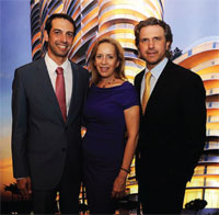 Martin Melo, left, and Carlos Melo of the Melo Group flank Alicia Cervera Lamadrid of Cervera Real Estate.