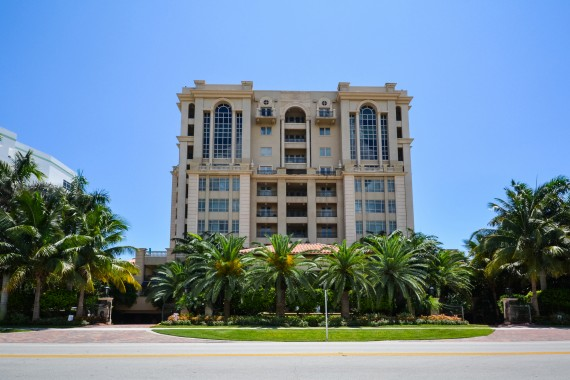 A street-level shot of the Luxuria building in Boca Raton