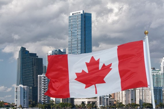 A December 2011 of Miami's skyline (Credit: John Spade) and the Canadian flag