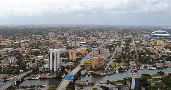 More details Aerial view of Little Havana, Miami River foreground, Marlins Park to the right, Coral Gables skyline in background, Coconut Grove and Biscayne Bay to the very left.