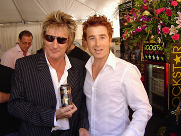 Singer-songwriter Rod Stewart, left, poses with Russell Weiner