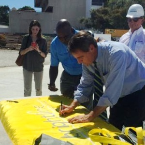 Fort Lauderdale Mayor Jack Seiler signs the Brightline flag Friday at the train station topping-off ceremony.
