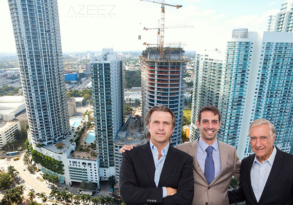 Aria on the Bay construction at the end of November. Inset: Carlos, Martin and Jose Melo