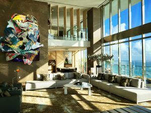A large art piece hangs from the unit's living room wall