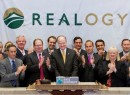 Realogy CEO Richard Smith at center