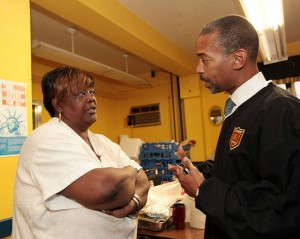 NYCHA Chairman John Rhea speaking to a resident of the Gravesend houses