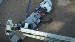 The flipped truck and collapsed crane at 438 West 38th Street in Hell's Kitchen (source: DNA Info)