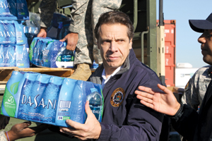 Governor Cuomo unloading water for storm victims.