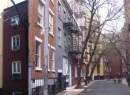 9 Minetta Lane (yellow building)