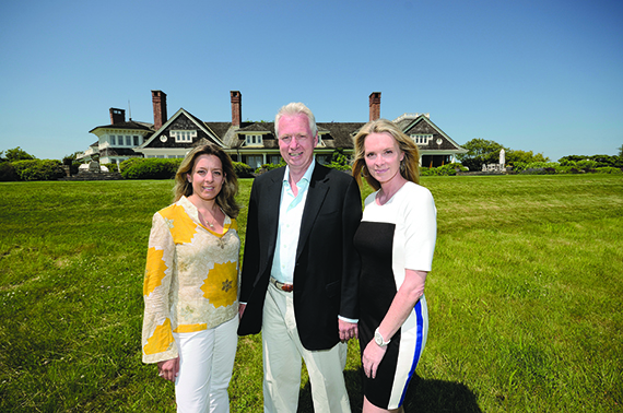 Brokers with some of the Hamptons' priciest listings (from left): Dana Trotter of Sotheby's, Paul Brennan  of Elliman; and Debbie Loeffler of Corcoran, at Loeffler's 315 Bridge Lane listing in Sagaponack.