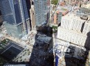 At 978 feet, 4 World Trade Center casts a shadow over the 9/11 Memorial below