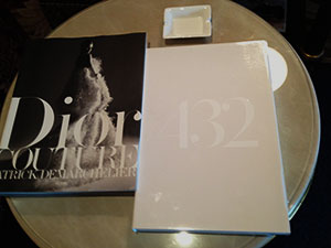 A 432 Park Avenue brochure alongside a Christian Dior brochure at Moscow's Ritz-Carlton hotel (Credit: Ronn Torossian)