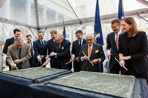 The Four Seasons team signs concrete of the new 30 Park Place tower.