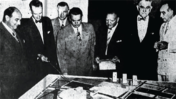 Zeckendorf and others looking at a Dream City model