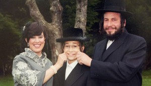 Menachem Stark (right) with his wife and son