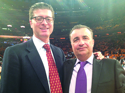 From left: Attorney Ed Mermelstein with One and Only Realty owner Gennady Perepada at a Knicks game