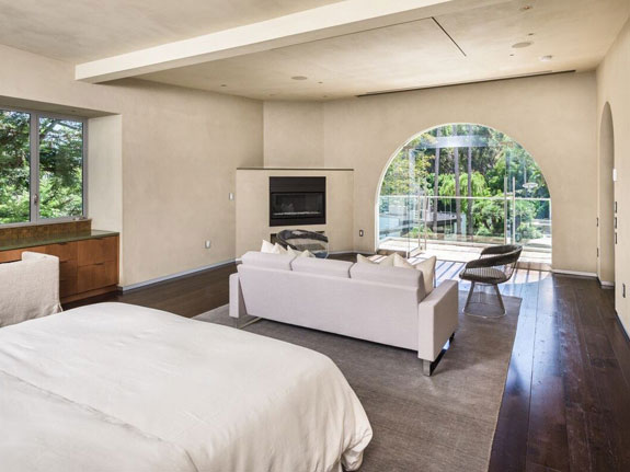 in-total-there-are-five-bedrooms-complete-with-beautiful-glass-windows-that-let-in-sunshine-and-surround-the-space-with-nature