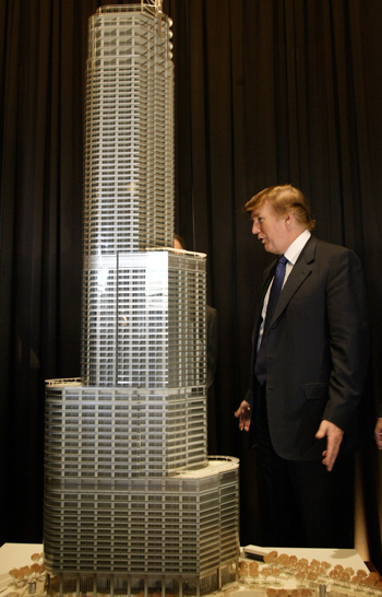 Donald Trump stands next to a model of Trump Tower Chicago in 2003