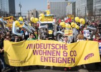 Demonstrators march to Berlin's Alexanderplatz protesting the city's rising rent prices in April 2019 (Credit: Getty Images)