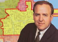 Ald. Brendan Reilly and a map of the 42nd Ward, which covers parts of the Loop, West Loop, Streeterville, River North and Gold Coast