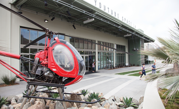 A Hughes 269A helicopter in front of an aircraft hangar once owned by Howard Hughes and now a home for YouTube in Playa Vista.