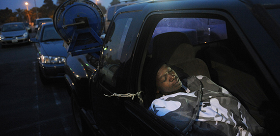 A woman sleeps in her car in Los Angeles (Credit: Mark Ralstone/AFP/Getty Images)