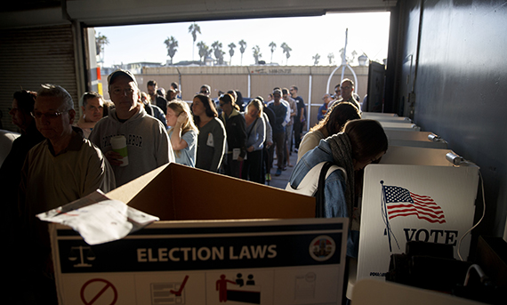 Voters wait in line to cast their ballots at the Venice Beach lifeguard station polling location in Los Angeles on Tuesday, Nov. 8, 2016. (Patrick T. Fallon/Getty Images)
