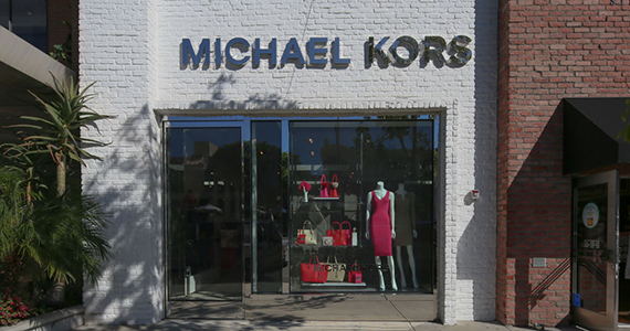 Michael Kors Holdings to close stores as sales lag