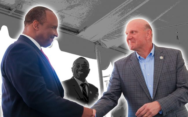 Inglewood Mayor James T. Butts and Clippers owner Steve Ballmer shake hands at a 2018 press conference for the stadium