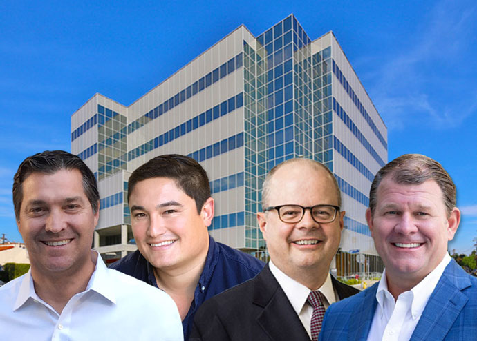 From left: Mark R. Laderman, Collin R. Komae, Walter P. Schmidt, and Christopher Peatross, with the $30 million office building bought by Rockwood and Artisan