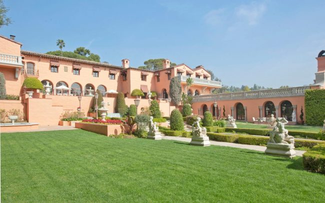 A view from side of back yard showing second terrace (Credit: Beverly House Estate)