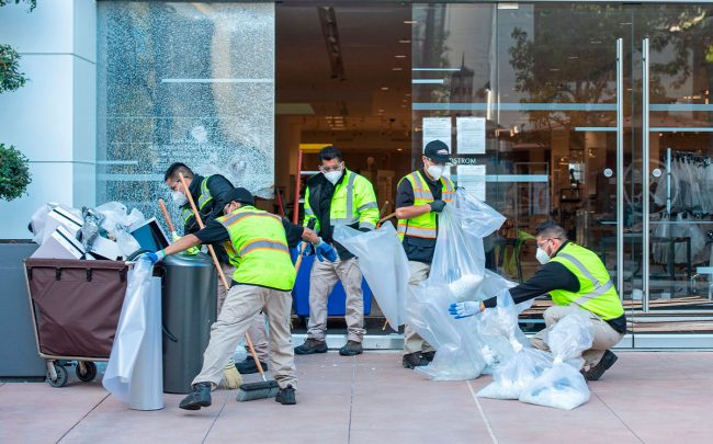 Workers clean up after demonstrations at the Grove Mall (Credit: VALERIE MACON/AFP via Getty Images)