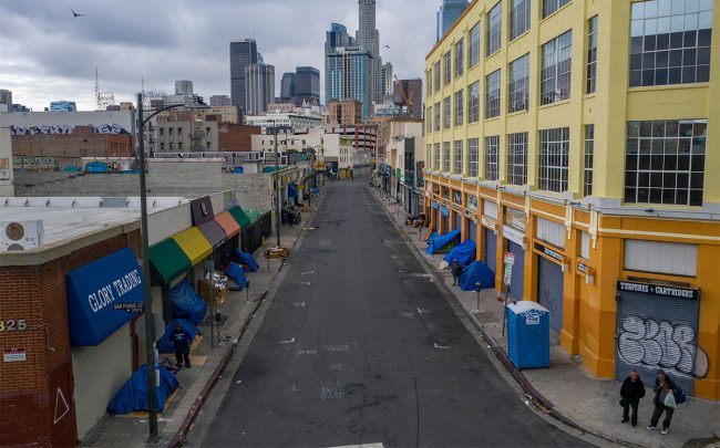Homeless tents lining sidewalks in Skid Row (Credit: David McNew/Getty Images)