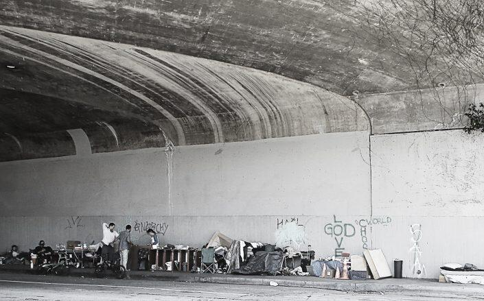 A homeless encampment under the 101 Freeway  (Getty)