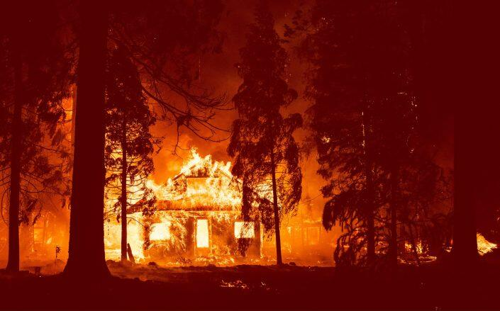 A home burning in the Sierra Nevada earlier this week (Getty)