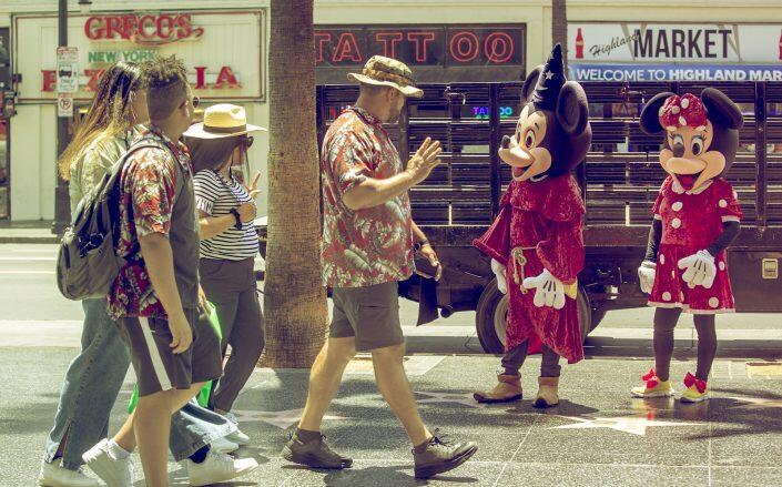 Street performers on Hollywood Boulevard as retail and tourism recovers in the state (Getty)