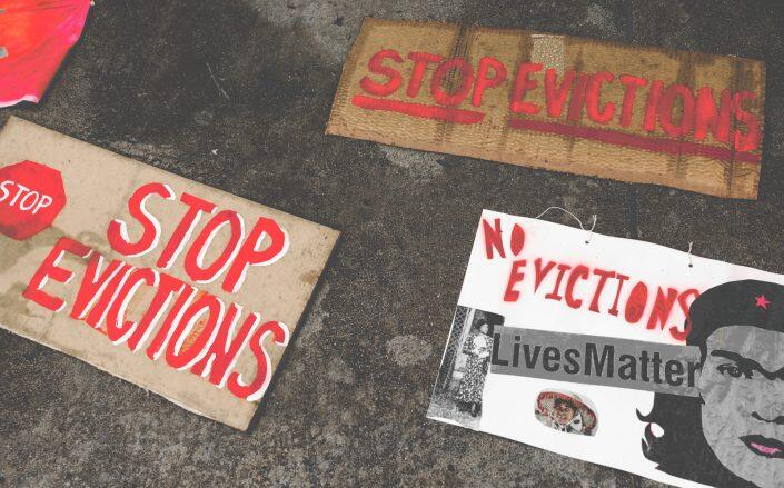 Signs from a protest in San Jose earlier this year to halt eviction proceedings (Getty)