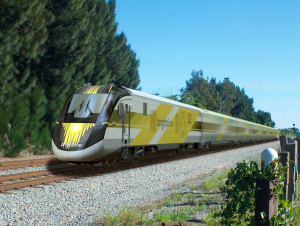 A frontal shot of Brightline's lead car, which feature yellow-and-black color schemes