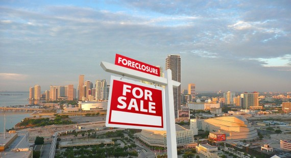 A June 2011 photo of the downtown Miami skyline (Credit: Marc Averette) and a foreclosure sign