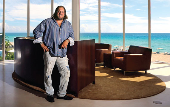 Gil Dezer steps out of his condo right onto the sand in Sunny Isles Beach.