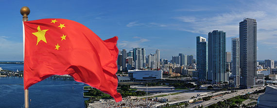 A 2011 photo of downtown Miami's skyline (Credit: Lonny Paul) and the Chinese flag (Credit: Daderot)