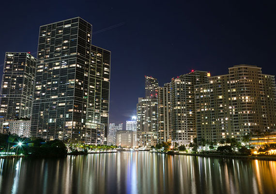 Night view of Brickell from the Brickell Key Bridge (Credit: EdoDodo)