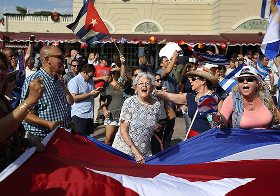 Miamians gather in the streets to celebrate Fidel Castro's death (Credit: Joe Radely / Getty Images)