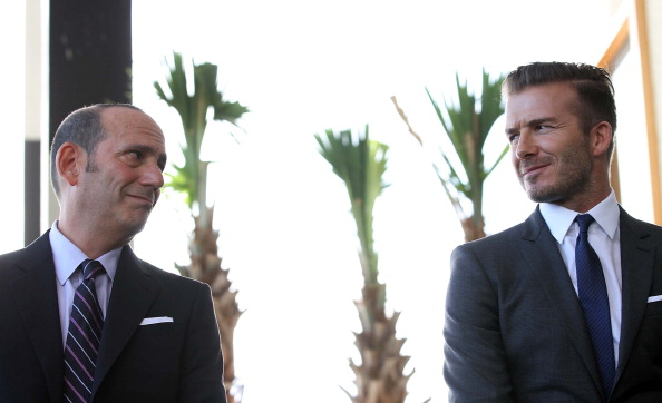 Commissioner Don Garber and David Beckham at a Miami press conference in 2014 (Credit: Getty Images)